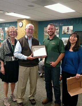 Mary Smith, Kevin O'Brien and Kim Coughlin-Lamphear presenting Travis with the SDRC Recognition Award